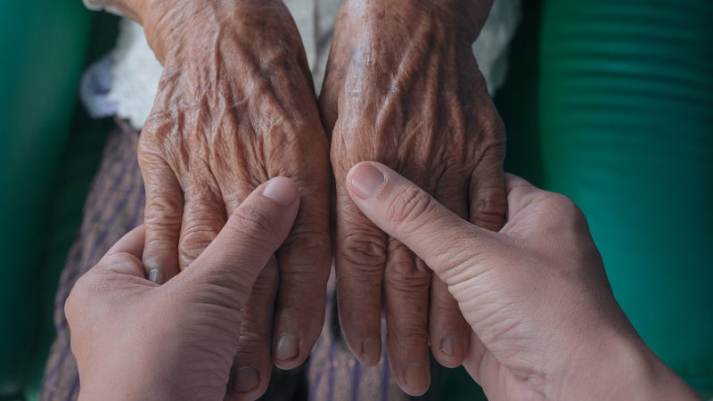 Person holding old persons hands