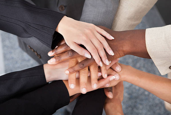 Diversity hands of different people together
