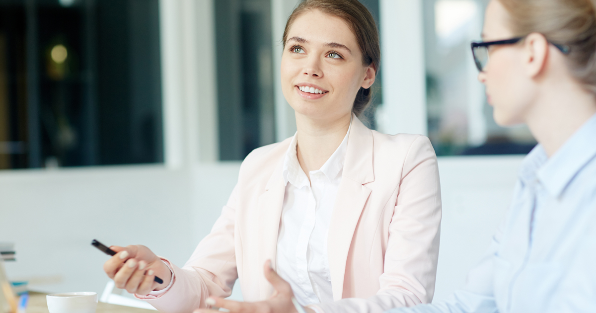 Woman in interview smiling and using hands